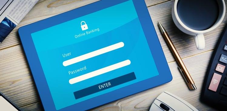 Online banking against tablet pc on desk.jpeg