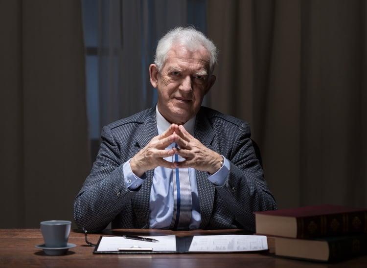 Senior businessman sitting at the office desk