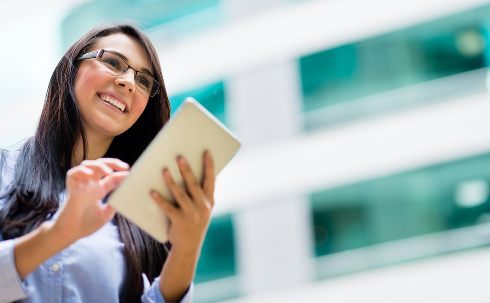 Successful business woman with a tablet computer
